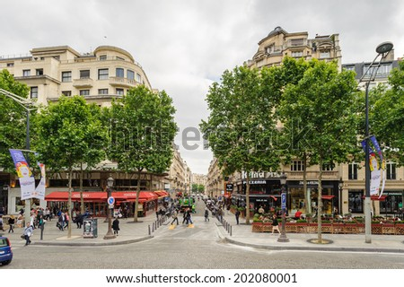PARIS, FRANCE - JUN 17, 2014: Avenue des Champs-Elysees in Paris, France. Champs-Elysees is one of the world's most famous streets, and is one of the most expensive strips of real estate in the world - stock photo