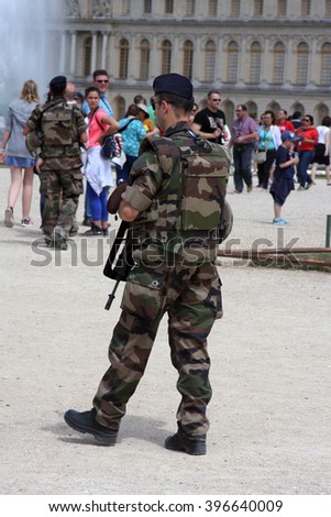 PARIS, FRANCE - JUNE 13, 2015: A member of France's armed forces patrols the Palace of Versailles on June 13, 2015. The Palace is not far from Paris. - stock photo