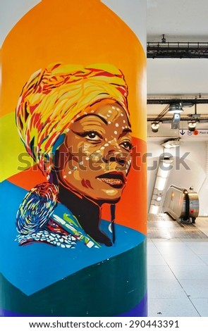 PARIS, FRANCE -20 JUNE 2015- Colorful street art portrait series by Barcelona based artist BTOY on display at the Gare du Nord railway station in Paris from 27 May to 8 July 2015.