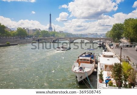PARIS, FRANCE - JUNE 16, 2011: Eiffel tower and ships on Seine