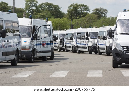 PARIS, FRANCE - JUNE  25, 2015 :  French police vans parked around Porte Maillot to transport Riot Squad because of the protest of the taxis against the service Ubber Pop.