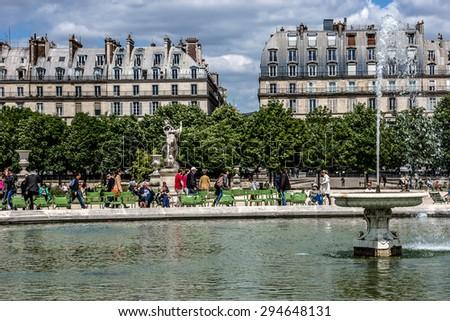 PARIS, FRANCE - JUNE 1, 2015: Local and Tourist in famous Tuileries garden. Tuileries Garden (Jardin des Tuileries) is a public garden located between the Louvre Museum and the Place de la Concorde. - stock photo