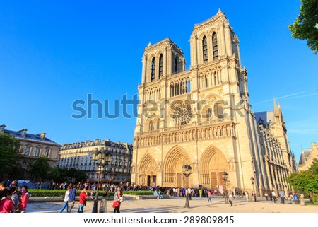 PARIS, FRANCE - JUNE 3, 2015: Notre Dame de Paris cathedral is one of the most visited places in France and one of the most famous symbols of Paris, June 3, 2015