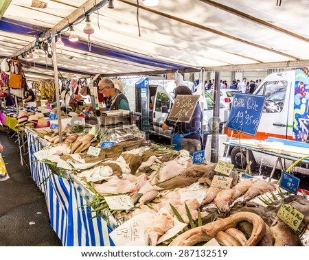 PARIS, FRANCE - JUNE 13, 2015: people buy at street market in Chaillot, Paris, France. At that6 farmers market people sell their fresh  own high quality products. - stock photo