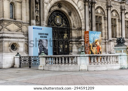 PARIS, FRANCE - JUNE 2, 2015: People on the Place de l'Hotel-de-Ville against the City Hall. The City of Paris's administration has been located on the same location since 1357.