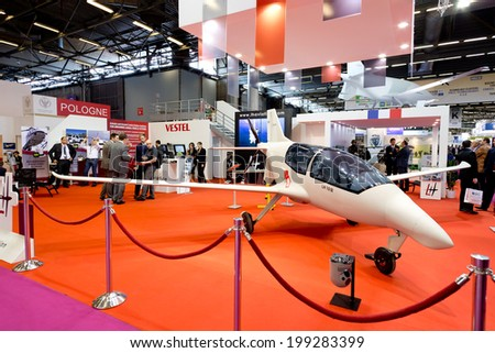 PARIS, FRANCE - JUNE 17, 2014: People visit stands at Eurosatory, the largest international land and air-land defense and security exhibition in Europe.