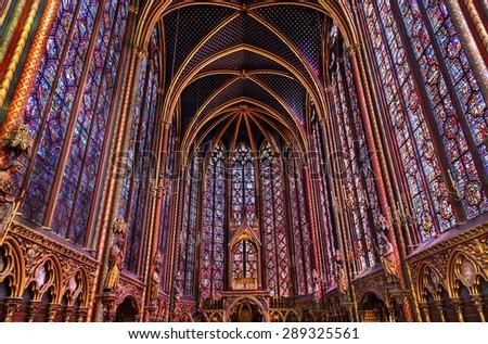 PARIS, FRANCE - JUNE 1, 2015 Stained Glass Cathedral Ceiling Saint Chapelle Paris France.  Saint King Louis 9th created Sainte Chapelle and stained glass in 1248. - stock photo