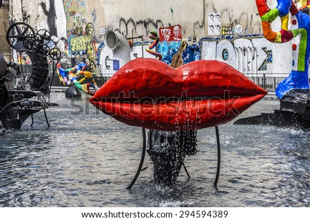 PARIS, FRANCE - JUNE 2, 2015: Stravinsky Fountain (1983) is a fountain with 16 works of sculpture, moving and spraying water, representing works of composer Igor Stravinsky. Place Stravinsky, Paris. - stock photo