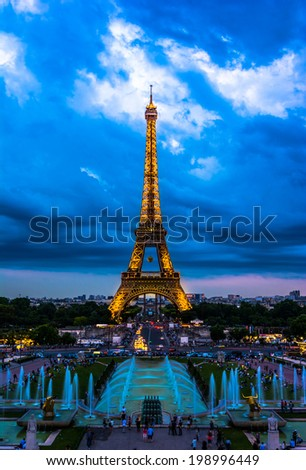 Paris, France - June 8th, 2014: Eiffel Tower illuminated at night-during Roland Garros tour. The Eiffel Tower was built in 1889, and is a popular attraction for tourists. - stock photo