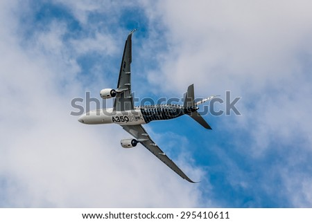 PARIS, FRANCE - JUNE 20, 2015: The Airbus A350 - mid-size long range and World's most modern and efficient aircraft, does a demonstration flight at 51st International Paris Salon (Le Bourget).