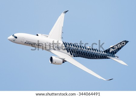 PARIS, FRANCE - JUNE 16, 2015: The Airbus A350 - mid-size long range and World's most modern and efficient aircraft, does a demonstration flight at the 51st International Paris Salon (Le Bourget). - stock photo