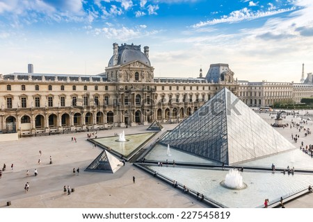 PARIS, FRANCE - JUNE 14, 2014: The Louvre Museum is one of the world's largest museums and the most popular tourist destinations in France - stock photo