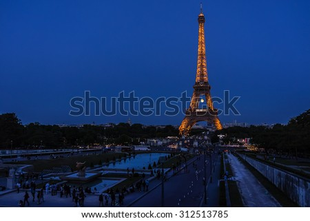 PARIS, FRANCE - JUNE 3, 2015: Tour Eiffel (Eiffel Tower) located on Champ de Mars, named after engineer Gustave Eiffel, most visited monument in the world. Night shot.
