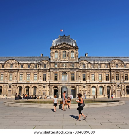 PARIS, FRANCE - JUNE 2: Tourists visit at courtyard of Louvre Museum in the morning On June 2, 2011 in Paris, France. The Louvre Museum is one of the world's largest museums - stock photo