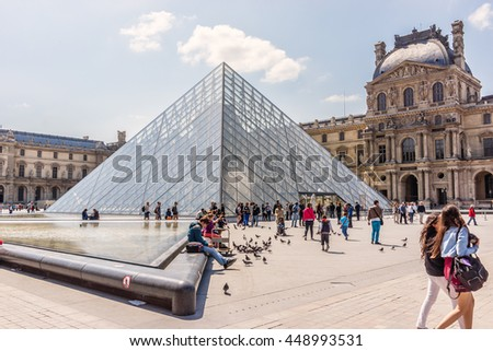 PARIS, FRANCE - JUNE 9, 2015: View Louvre Museum courtyard on the Sunset. Louvre Museum is one of the largest and most visited museums worldwide. - stock photo