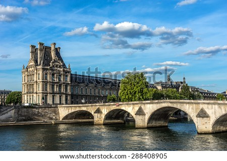 PARIS, FRANCE - JUNE 1, 2015: View of famous Louvre Museum from the Seine River at sunset. Louvre Museum is one of the largest and most visited museums worldwide. - stock photo