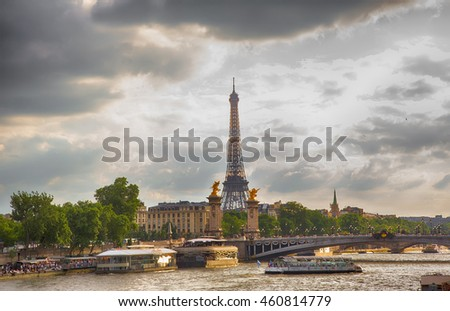 PARIS, FRANCE - JUNE 24, 2016. View of the famous Bridge of Alexandre III over Seine river and the Eiffel tower. Summer evening