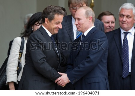 PARIS, FRANCE - JUNE 21, 2011 : Vladimir Putin and Nicolas Sarkozy, during a work visit at Palais de l'Elysee - stock photo