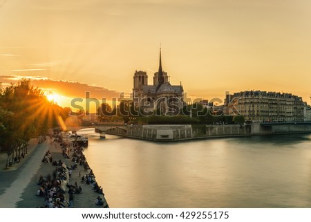 Paris, France landmarks - Cathedral of Notre Dame de Paris at sunset in Paris, France. Paris is the capital and most populous city of France.  - stock photo