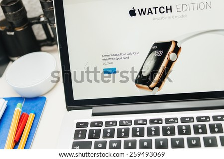 PARIS, FRANCE - MAR 10, 2015: Apple Computers website on MacBook Retina in room environment showcasing the price of 12000 USD for the golden Apple Watch Edition as seen on 10 March, 2015 - stock photo