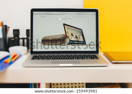 PARIS, FRANCE - MAR 10, 2015: Apple Computers website on MacBook Retina in room environment showcasing new MacBook and Beats portable loudspeaker as seen on 10 March, 2015 - stock photo