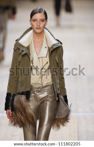 PARIS, FRANCE- MARCH 3: A model walks runway during the Barbara Bui Ready to Wear Autumn/Winter 2011/2012 show during Paris Fashion Week at Pavillon Concorde on March 3, 2011 in Paris, France. - stock photo