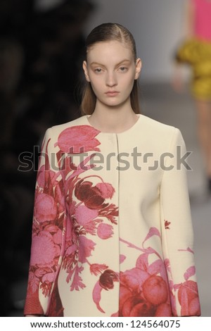PARIS, FRANCE - MARCH 07: A model walks the runway at the Giambattista Valli fashion show during Paris Fashion Week on March 7, 2011 in Paris, France. - stock photo