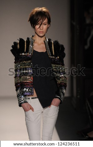 PARIS, FRANCE - MARCH 3: A Model walks the runway during the Balmain Ready to Wear Autumn/Winter 2011/2012 show during Paris Fashion Week at Le Grand Hotel on March 3, 2011 in Paris, France. - stock photo