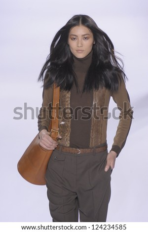 PARIS, FRANCE - MARCH 07: A model walks the runway during the Chloe Ready to Wear Autumn/Winter 2011/2012 show during Paris Fashion Week at Espace Ephemere Tuileries on March 7, 2011 in Paris, France - stock photo