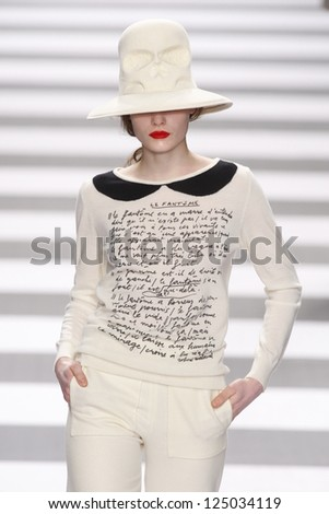 PARIS, FRANCE - MARCH 08: A model walks the runway during the Jean-Charles de Castelbajac Autumn/Winter 2011/2012 show during Paris Fashion Week at Pavillon Concorde on March 8, 2011 in Paris, France. - stock photo