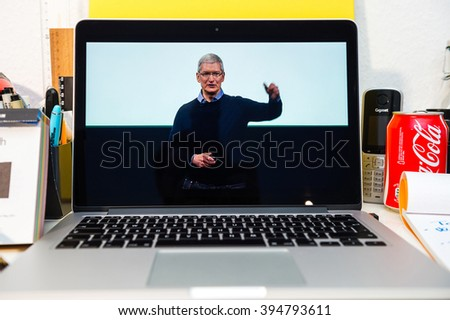 PARIS, FRANCE - MARCH 21, 2016: Apple Computers website on MacBook Pro Retina in a creative room environment showcasing Apple Event with Tim Cook saying thank you for coming - stock photo