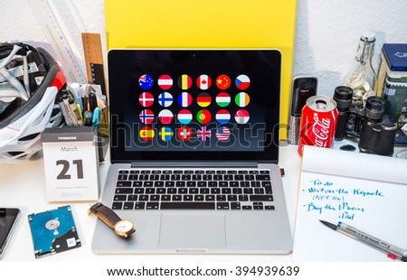 PARIS, FRANCE - MARCH 21, 2016: Apple Computers website on MacBook Pro Retina in a creative room environment showcasing Apple Event with list of countries where's Apple is 100% renewable energy - stock photo