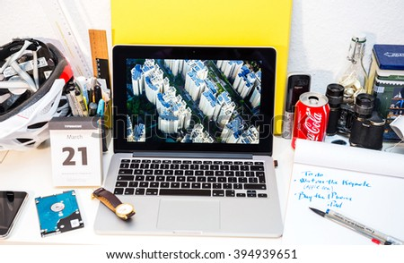 PARIS, FRANCE - MARCH 21, 2016: Apple Computers website on MacBook Pro Retina in a creative room environment showcasing Apple Event with Lisa Jackson presenting solar plant in Singapore - stock photo