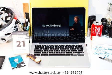 PARIS, FRANCE - MARCH 21, 2016: Apple Computers website on MacBook Pro Retina in a creative room environment showcasing Apple Event with Lisa Jackson talking about renewable energy - stock photo