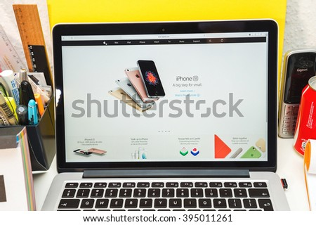 PARIS, FRANCE - MARCH 21, 2016: Apple Computers website on MacBook Pro Retina in a geek creative room environment showcasing the newly announced  - stock photo