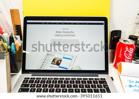 PARIS, FRANCE - MARCH 21, 2016: Apple Computers website on MacBook Pro Retina in a geek creative room environment showcasing the newly announced iPad pro with Apple Sim - stock photo