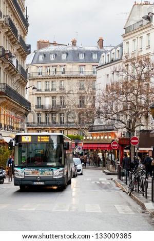 PARIS, FRANCE - MARCH 8: boulevard in Saint-germain-des-Pres district. District commercial growth began upon the 1886 completion of its Boulevard Saint-Germain in Paris, France on March 8, 2013 - stock photo