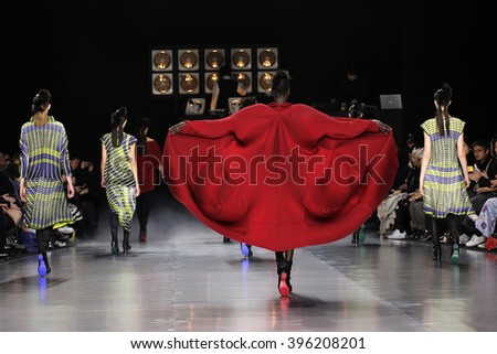 PARIS, FRANCE - MARCH 04: Designer Yoshiyuki Miyamae ackowledges the applause of the public after Issey Miyake show as part of the Paris Fashion Week F/W 2016/2017 on March 4, 2016 in Paris, France. - stock photo