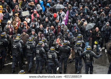 Paris, FRANCE - MARCH 31, 2016 : French police (anti-riot squad) try to control students during the demonstration against the El Khomri working law (labor law reforms). - stock photo