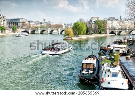 PARIS, FRANCE - MARCH 27: Ile de la Cite Island with the Pont Neuf bridge on March 27, 2014 in Paris. The Pont Neuf is the oldest standing bridge across the river Seine in Paris. - stock photo
