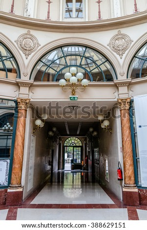 PARIS, FRANCE - MARCH 8, 2015: Interior of Galerie Colbert (architect Jacques Billaud, 1826) - covered Passage 83m long, is located in Quarter Vivienne.