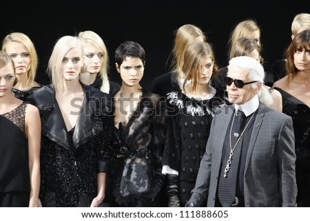 PARIS, FRANCE - MARCH 08: Karl Lagerfield and models walks the runway during the Chanel Autumn/Winter 2011/2012 show during Paris Fashion Week at Grand Palais on March 8, 2011 in Paris, France. - stock photo