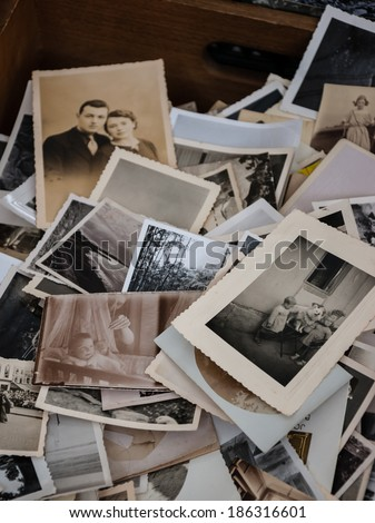 """PARIS, FRANCE - MARCH 10, 2013: Old photos for sale at flea market. """"Flea market"""" is a later translation of french term for the second hand stalls that appeared about 1860. - stock photo"""