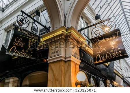 PARIS, FRANCE - MARCH 8, 2015: Passage des Panoramas is the oldest covered passages of Paris. Passage was opened in 1800 on site of town residence of Marechal de Montmorency, Duke of Luxembourg.