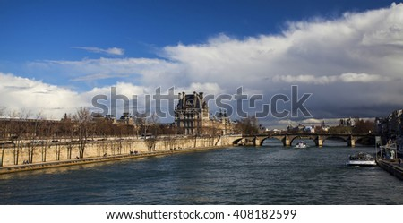 PARIS, FRANCE- MARCH 28, 2016: Pont Neuf bridge in the sunset, and stormy sky, Ile de la Cite, Paris - France