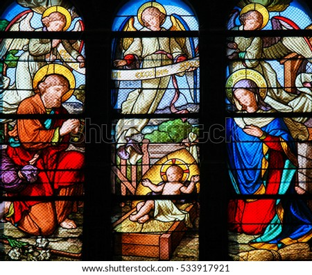 PARIS, FRANCE - MARCH 7, 2011: Stained Glass in Sainte Eustache Church in Paris, France, depicting a Nativity Scene at Christmas