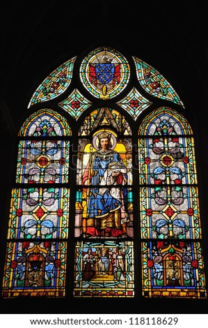 PARIS, FRANCE-MARCH 22: Stained glass window in Eglise St Germain l'Auxerrois with medieval scenes on March 22, 2009 in Paris. Mixed styles church is known from 7 century and was rebuilt many times.