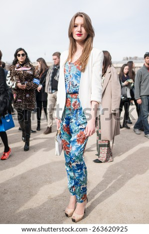 PARIS, FRANCE - MARCH 7, 2015: Stylish European woman with flower pattern dress in the Tuileries Garden. Paris Fashion Week: Ready to Wear 2015/2016 is held from March 3 to 11, 2015. - stock photo