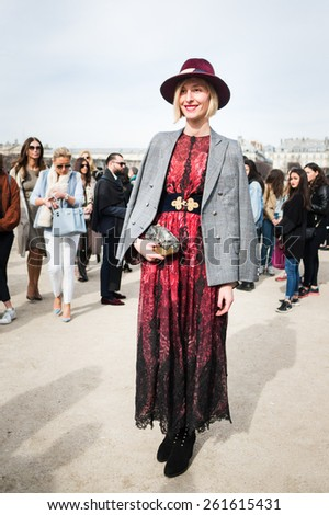 PARIS, FRANCE - MARCH 7, 2015: Stylish European woman with flower pattern skirt in the Tuileries Garden. Paris Fashion Week: Ready to Wear 2015/2016 is held from March 3 to 11, 2015. - stock photo