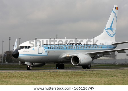 PARIS, FRANCE - MARCH 29: Tarom Boeing 737-78J taxis around CDG Airport on March 29, 2010. Tarom is the flag carrier and oldest currently operating airline of Romania. - stock photo